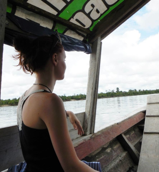 Riding in a boat up the Amazon River